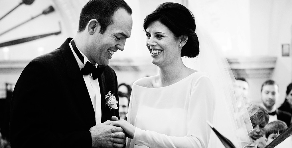 creative documentary wedding photographer cambridge normanton church rutland bride groom laugh during vows