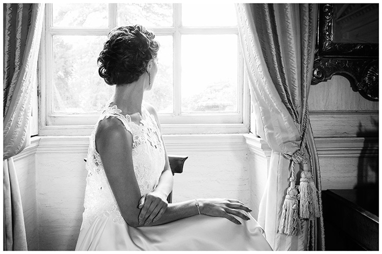 Bridal Gown Gorgeousness Dress Day UK London Bride sat looking out of window
