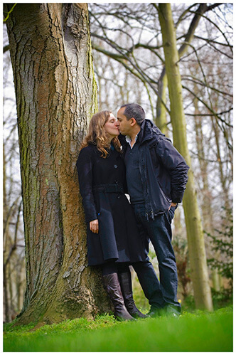Cambridge Pre Wedding Photography couple kissing leaning against tree