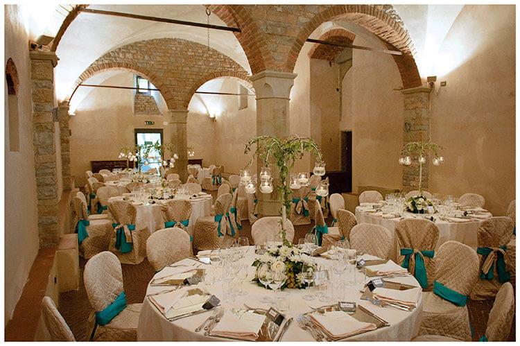 Castel di Poggio wedding venue tables decorated for dinner