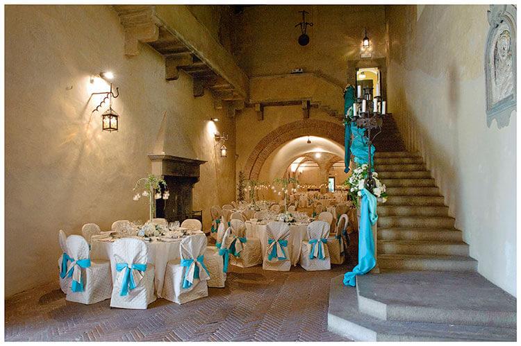 Castel di Poggio wedding venue interior decorated in blue ribbon