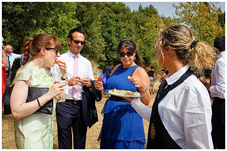 Castel di Poggio wedding serving food