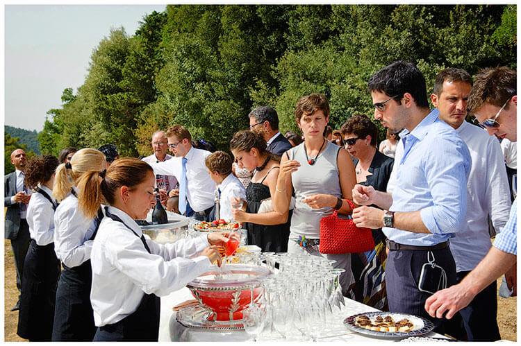 Castel di Poggio wedding guests being served drinks