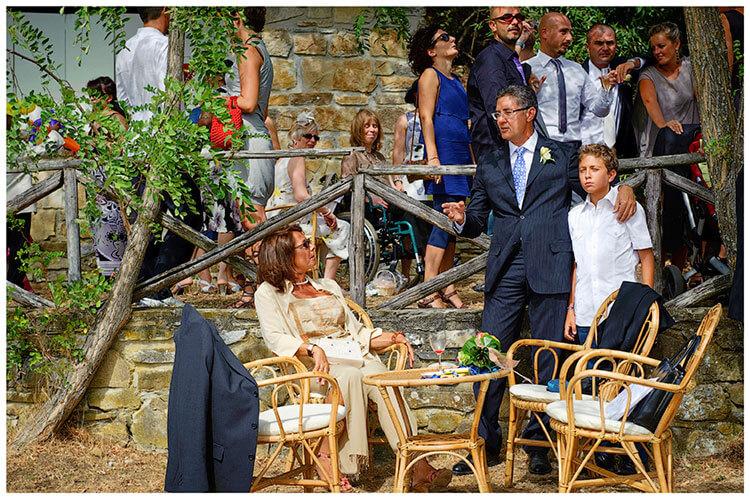 Castel di Poggio wedding guests in conversation