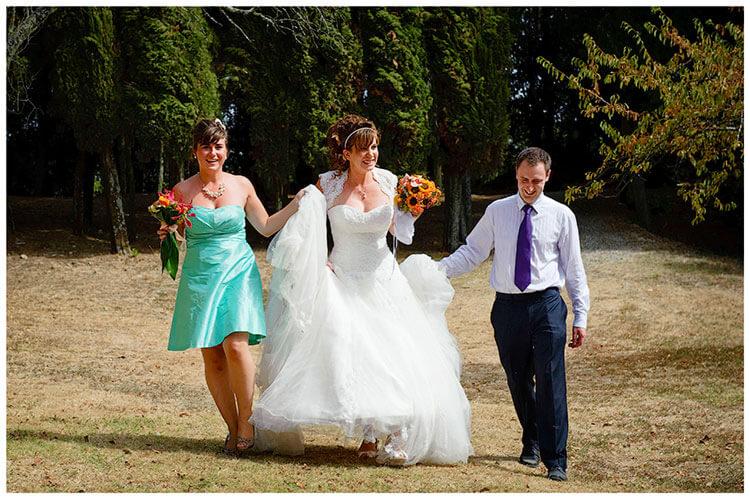 Castel di Poggio wedding bride helped to party