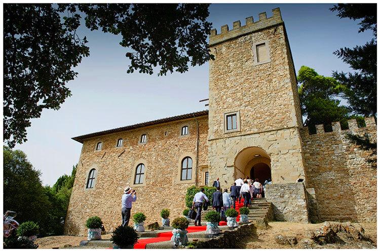 Castel di Poggio wedding guests going into castle along red carpet