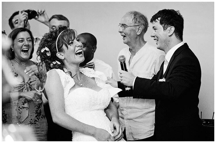 Castel di Poggio wedding laughing bride during grooms speech