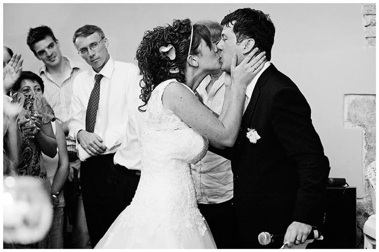 Castel di Poggio wedding kiss for the groom