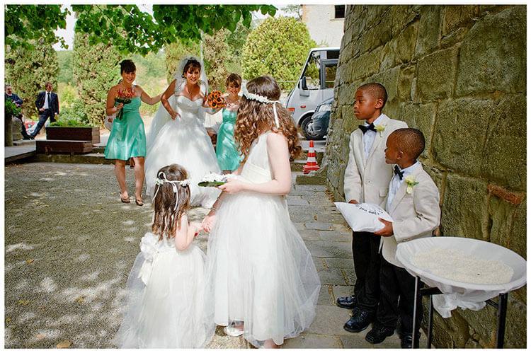 Fraternita di Romena wedding bride greeted by bridesmaids paige boys
