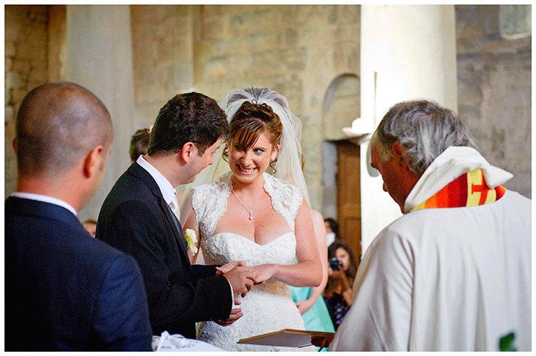 Fraternita di Romena wedding smiling bride exchange rings