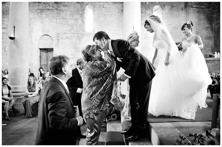 Fraternita di Romena wedding groom kisses mothers forehead