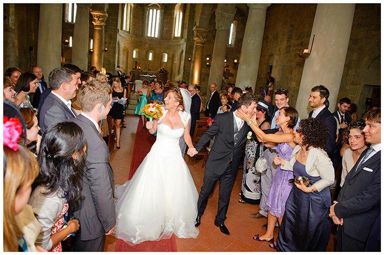 Fraternita di Romena wedding bride groom walking down aisle congratulations