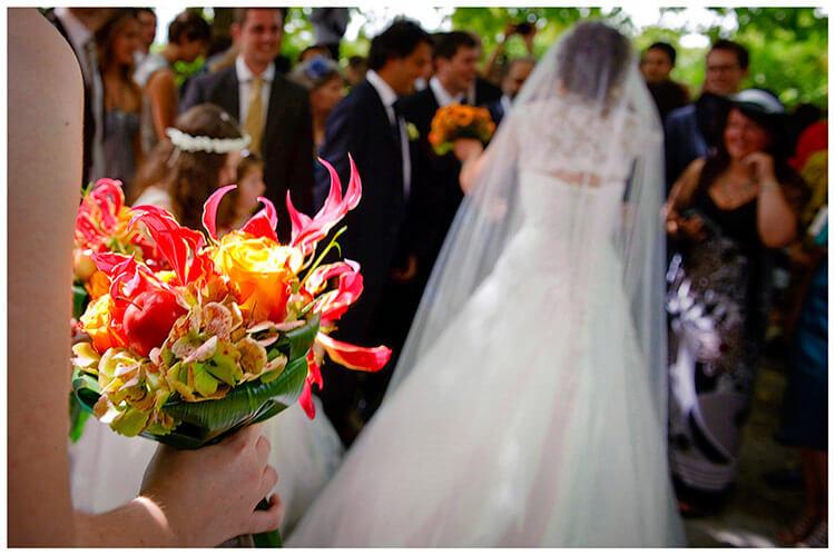 Fraternita di Romena wedding red bouquet bridal dress