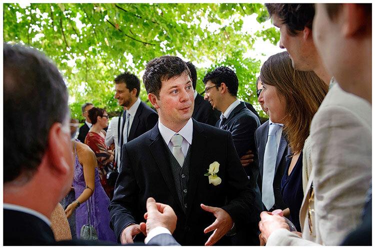 Fraternita di Romena wedding groom talking to guests