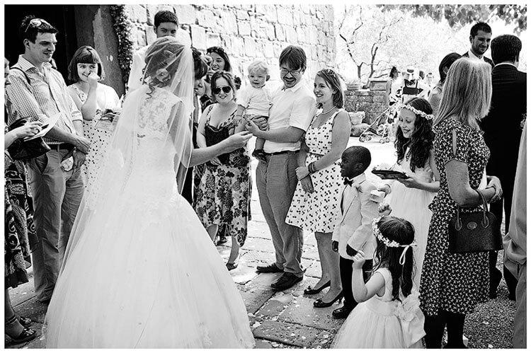 Fraternita di Romena wedding bride talking to guest outside Church