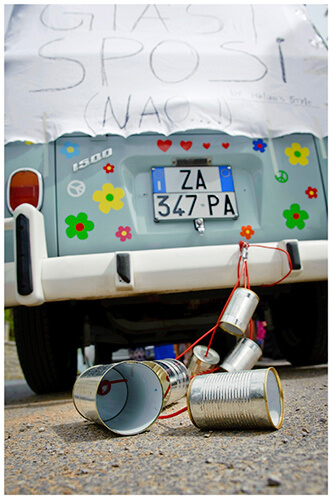 Fraternita di Romena wedding Italy cans and sign tied to back of flowery blue VW Camper