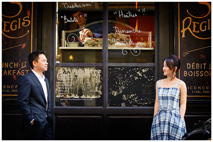 Paris pre-wedding photography couple in front of cake window