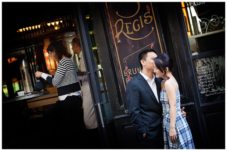 Paris pre-wedding photography a kiss in front of french cafe