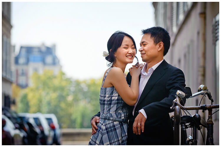 Paris pre-wedding photography smiling couple embrace