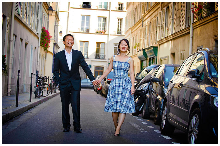 Paris pre-wedding photography couple hold hands walking streets of paris