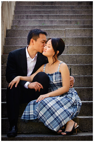 Paris pre-wedding photography couple kiss sitting on steps