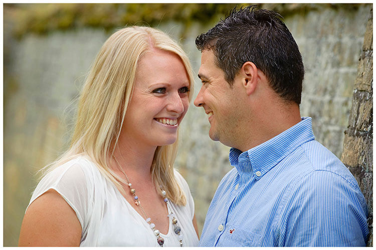 Pre-Wedding Photography at Wimpole Hall couple smiling gaze into each others eyes