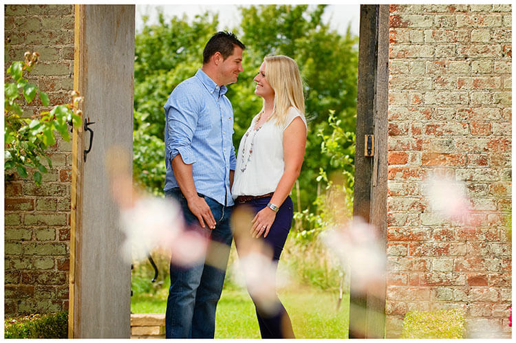 Pre-Wedding Photography at Wimpole Hall couple standing in garden doorway