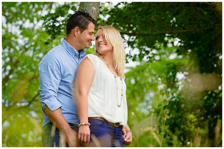 Pre-Wedding Photography at Wimpole Hall couple in wood land