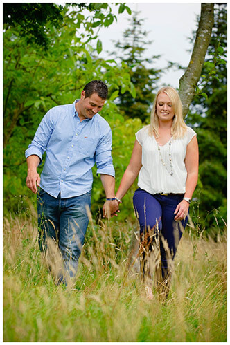 Pre-Wedding Photography at Wimpole Hall couple walking in long grass
