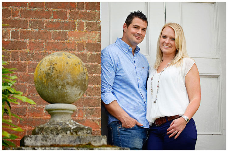 Pre Wedding Photography at Wimpole Hall Dan and Vicky standing in doorway