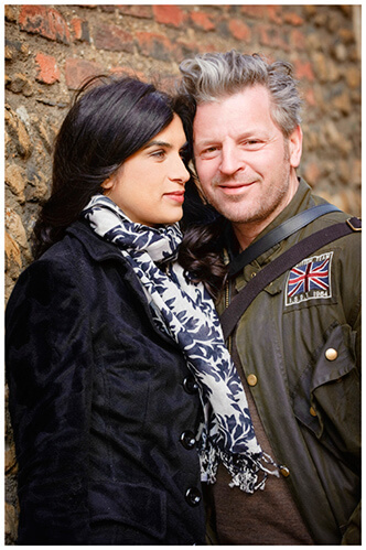 pre-wedding photography Cambridge rock and Melanie leaning against wall