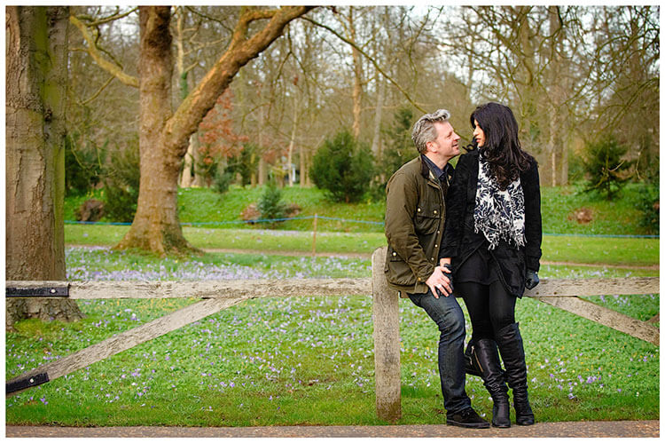 pre-wedding photography Cambridge couple sitting on low wooden fence