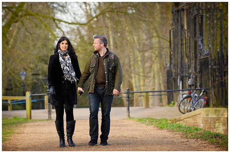 pre-wedding photography Cambridge Rock & Melanie walk holding hands on gravel path