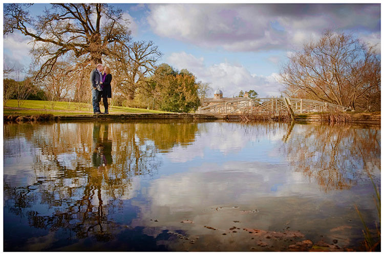 Sculpture Gallery Pre-Wedding photography couple standing near water with wooden bridge in background