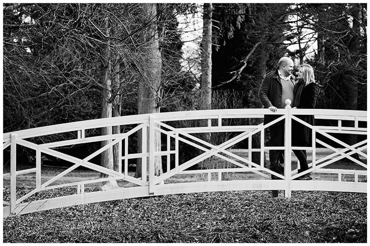 Sculpture Gallery Pre-Wedding photography couple embrace standing on foot bridge