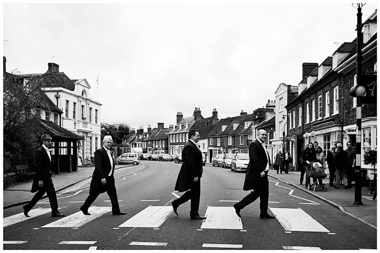 Woburn Inn wedding groom crosses zebra crossing with grooms men