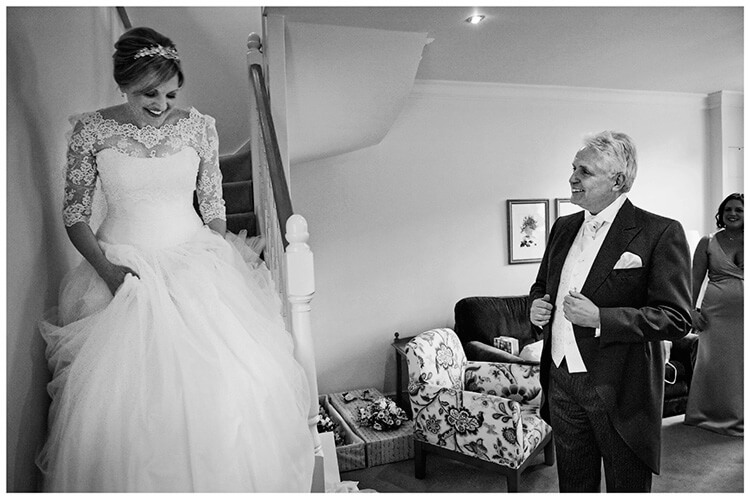 Woburn Inn wedding bride comes down stairs watches by her happy father