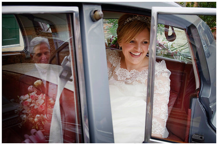 Woburn Church wedding smiling bride in car father reflection in window