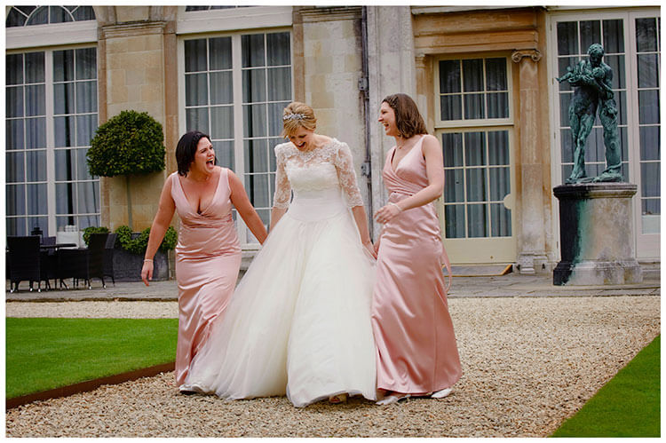 Woburn Sculpture Gallery wedding bride and bridesmaids laughing
