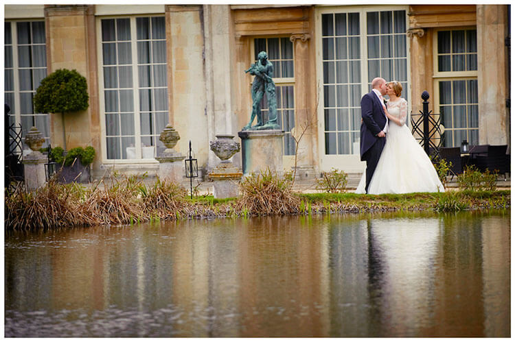 Woburn Sculpture Gallery wedding bride groom kiss near waters edge