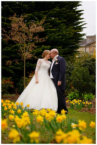 Woburn Sculpture Gallery wedding kissing amongst daffodils