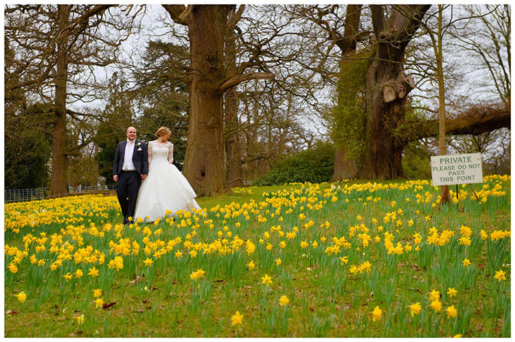 Woburn Sculpture Gallery wedding bride groom walking in daffodils please do not enter sign