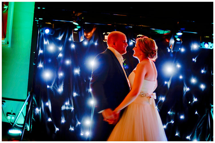 Woburn Sculpture Gallery wedding couple dance in front of disco lights