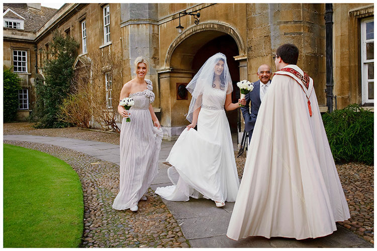 Christ's College wedding bridal party greeted by vicar