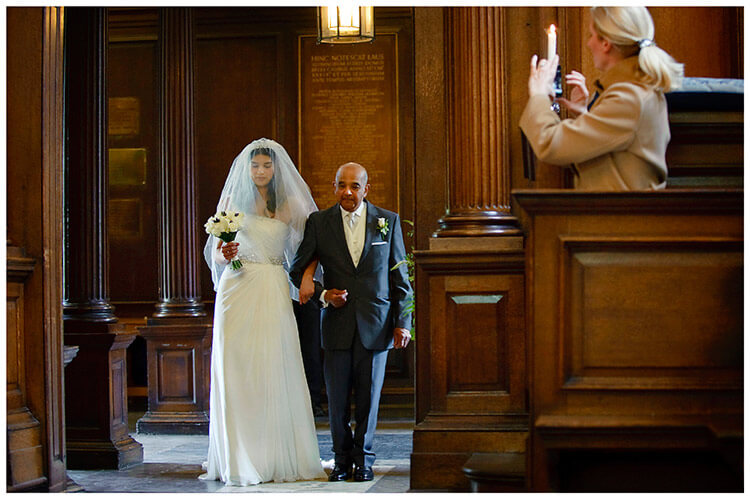 Christ's College wedding bride enters chapel on father arm guest takes photo on phone