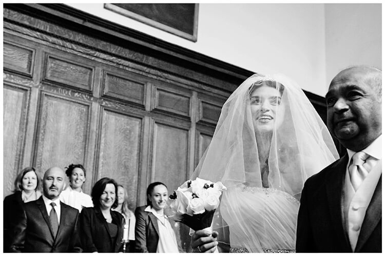 Christ's College wedding smiling bride guests in chapel