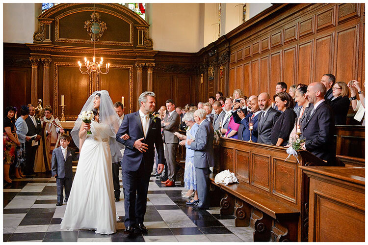 Christ's College wedding big smiles walking down aisle