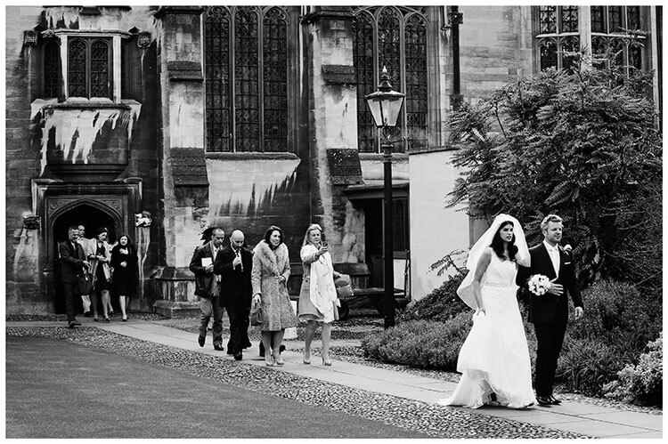 Christ's College wedding walking happy couple followed by guests