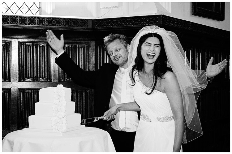 Christ's College wedding bride laughs during cake cutting