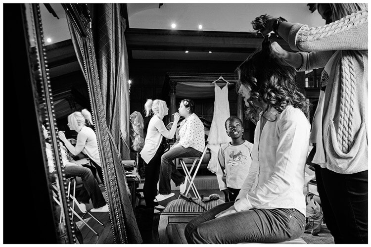 Wedding photography at Hengrave Hall bride getting ready